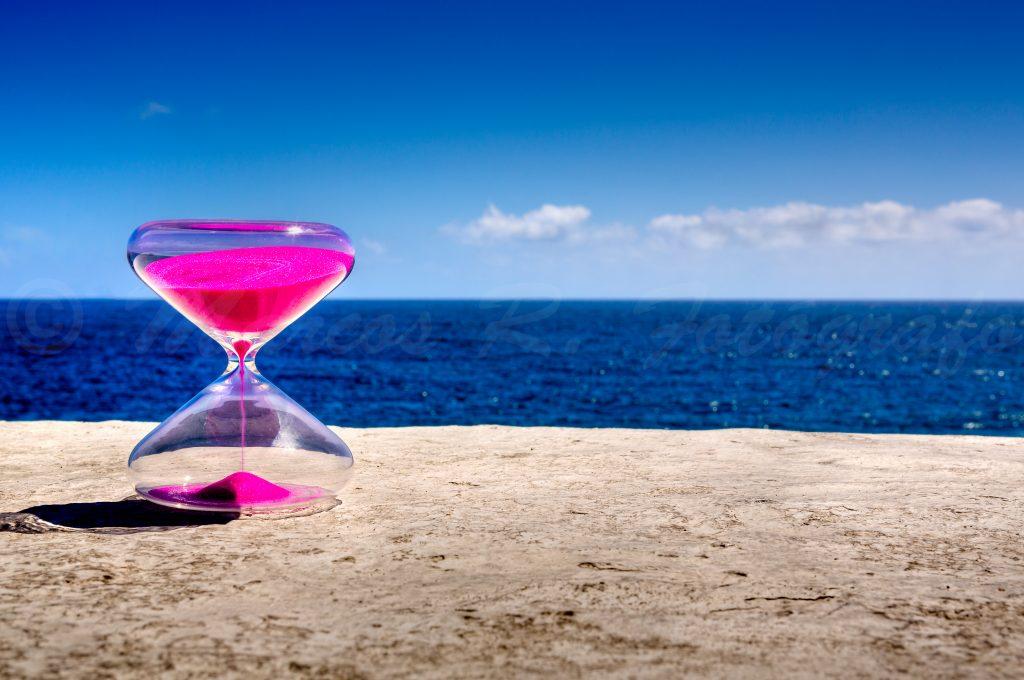 Reloj de arena en la playa
